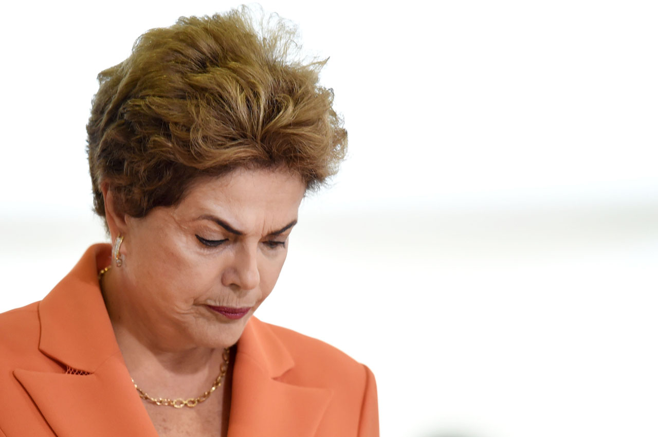 Brazilian President Dilma Rousseff attends the launching of the Agricultural and Livestock Plan for 2016/2017, at Planalto Palace in Brasilia, on May 4, 2016. Rousseff is fighting impeachment on allegations that she illegally borrowed money to boost public spending during her 2014 re-election campaign. / AFP PHOTO / EVARISTO SA