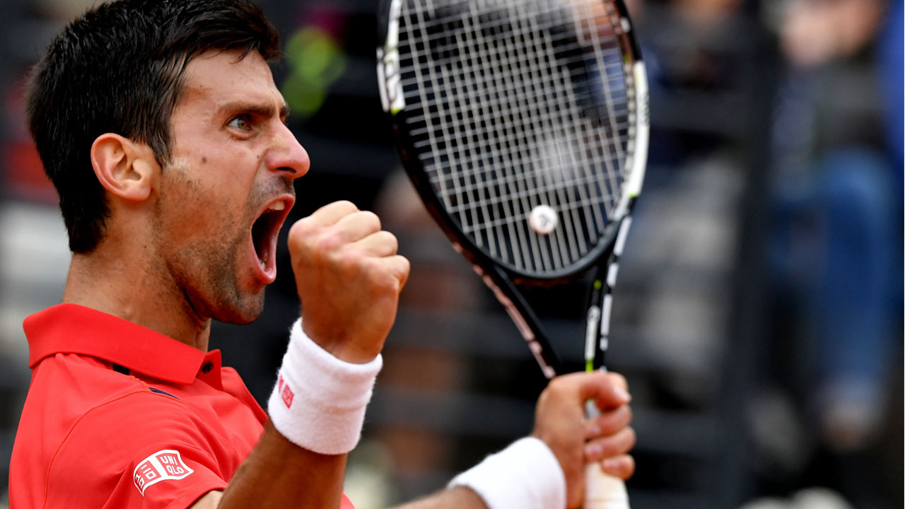Serbia's Novak Djokovic reacts against Spanish Rafael Nadal during the ATP Tennis Open tournament at the Foro Italico, on May 13, 2016 in Rome. / AFP PHOTO / TIZIANA FABI