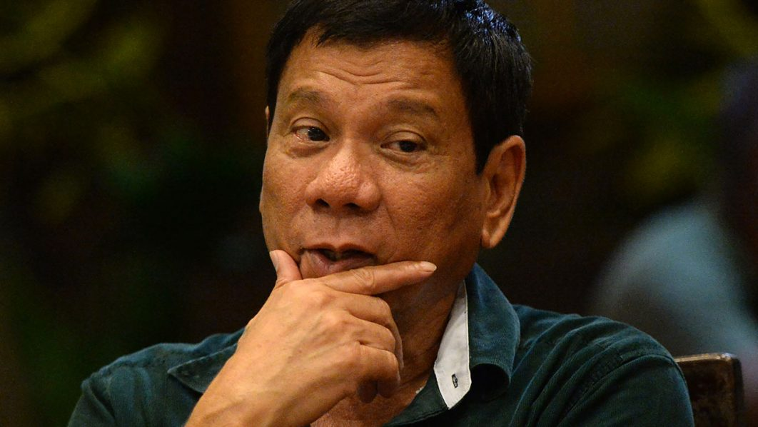 This photo taken on May 15, 2016 shows Philippines' president-elect Rodrigo Duterte gesturing as he talks with military and police officials during an informal meeting at a hotel in Davao City, in the southern island of Mindanao.  Business titans, turncoat politicians, celebrities and rebel leaders are descending on the long-neglected far southern Philippines, hoping to gain favour with the nation's shock new powerbroker. The remote and dusty city of Davao has suddenly become the country's new seat of power after hometown hero Rodrigo Duterte won last week's presidential election in a landslide.  / AFP PHOTO / TED ALJIBE
