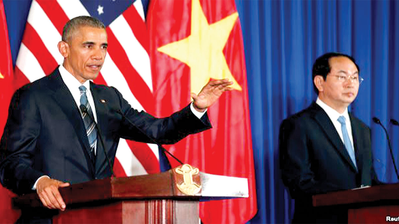 U.S. President Barack Obama (left) during a press conference with Vietnam's President Tran Dai Quang at the Presidential Palace Compound in Hanoi, Vietnam…yesterday