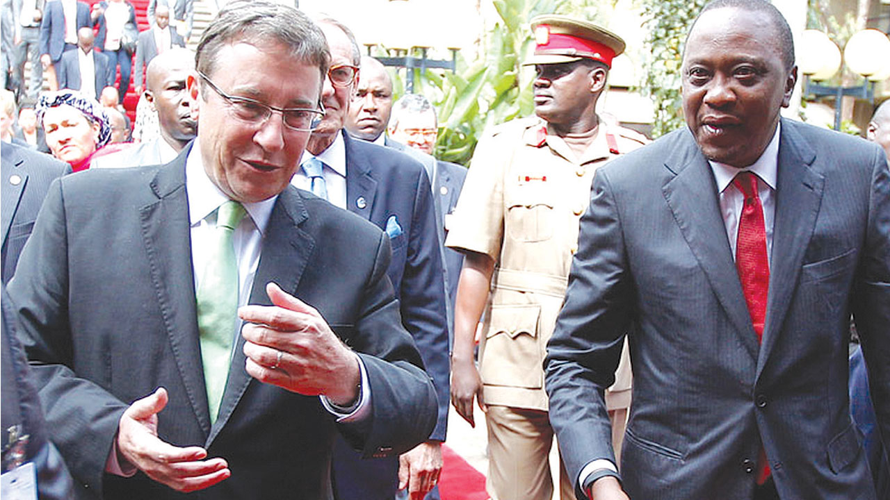 UNEP Executive Director Achim Steiner (left) and President Uhuru Kenyatta of Kenya arrive for the opening of the high-level segment of the United Nations Environment Assembly (UNEA-II) in Nairobi, Kenya. Photo: UNEP