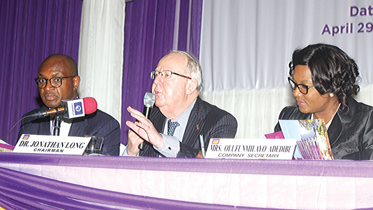 Group Managing Director/Chief Executive Officer, First City Monument Bank Limited, Ladi Balogun (left);  Chairman of FCMB Group, Dr. Jonathan Long; and Company Secretary, Mrs Olufunmilayo Adedibu, at the third yearly general meeting of the bank in Lagos.