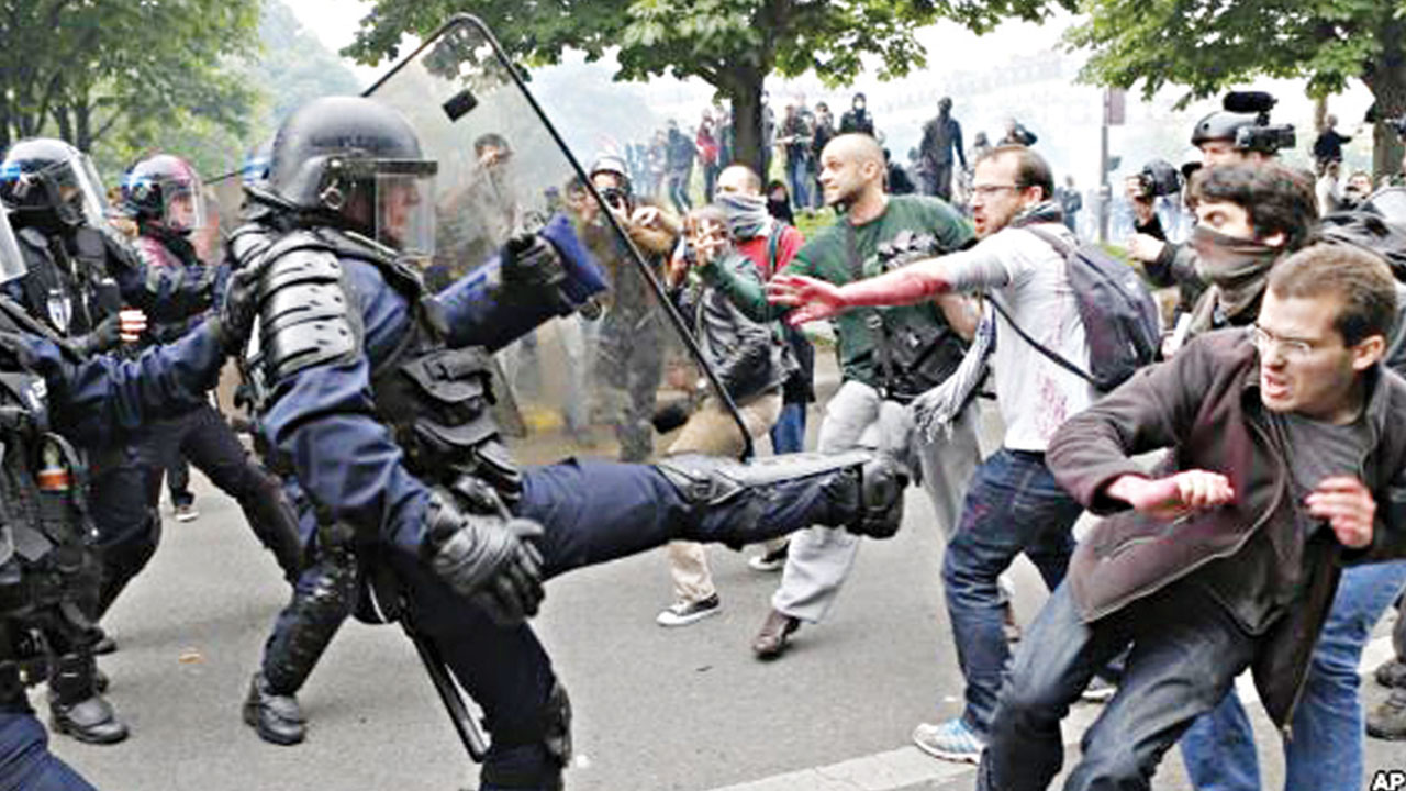 Riot police officers clash with protesters during a demonstration held as part of nationwide labour actions in Paris, France…yesterday