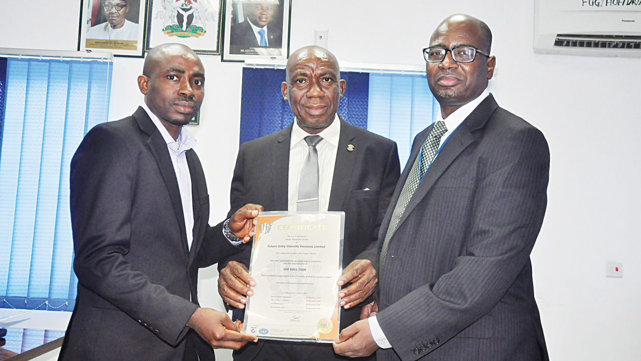 International Organization for Standardization (ISO) representative, Babatunde Ajayi (left); Ag. Chairman,  FUG Pensions, Adeyinka Sogunle;  Managing Director and Chief Executive,  Usman B. Suleiman, at the presentation of ISO certification to the company in Lagos