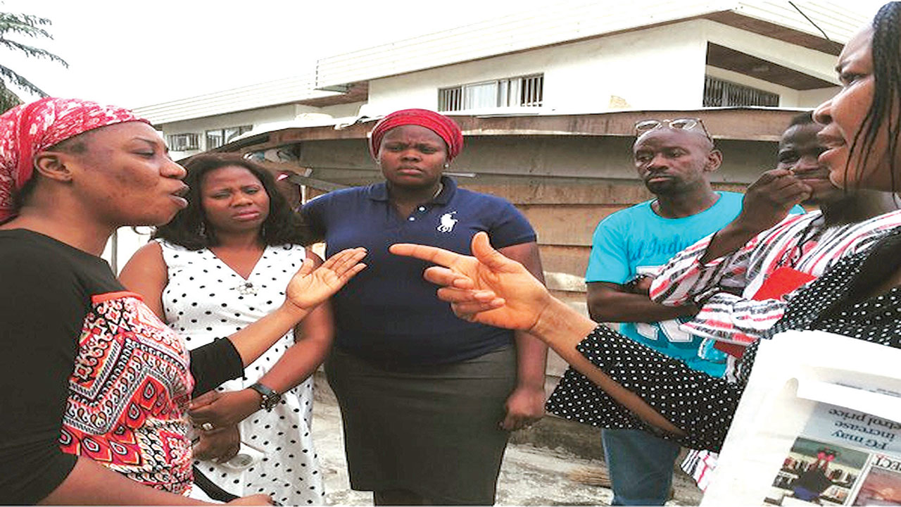 Dr. Joe Okei-Odumakin (right) with victim's relatives...yesterday