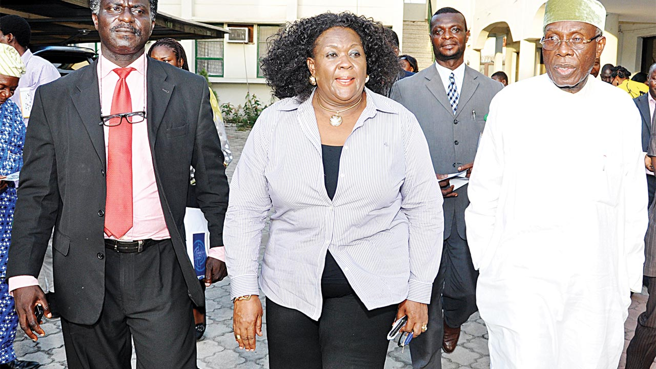 Minister for Agriculture, Chief Audu Ogbe (right); Director-General/Chief Executive Officer (CEO), Federal Institute of Industrial Research Oshodi (FIIRO), Lagos, Dr. Gloria Elemo; and Director of Linkages and Extension, FIIRO, Dr. Dele Oyeku, at the working visit of the minister to the institute PHOTO: VICTORIA NJOKU