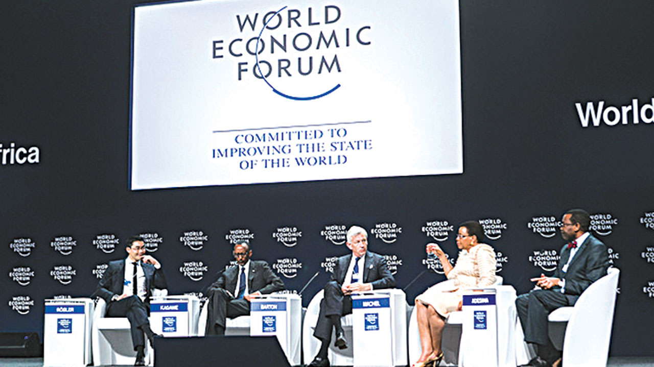 MACROBUTTON HTMLDirect Head of the Centre for Regional Strategies and Member of the Managing Board, World Economic Forum, Philipp Rösler (left); President of the Republic of Rwanda, Paul Kagame; Global Managing Director, McKinsey and Company, USA, Dominic Barton; Founder, Graça Machel Trust, South Africa, Graca Machel; President, African Development Bank, Akinwumi Ayodeji Adesina, at the World Economic Forum on Africa 2016 in Kigali, Rwanda. PHOTO: WEF/Benedikt von Loebell