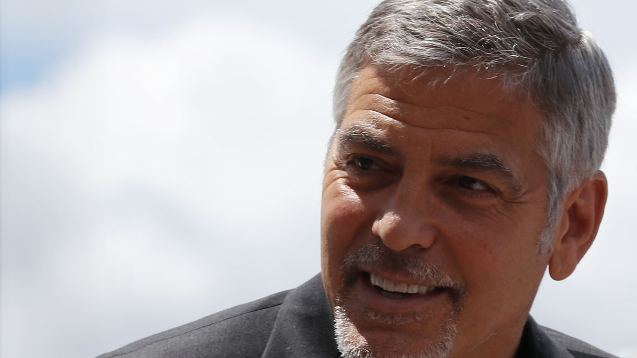 """US actor George Clooney arrives to attend a photocall for the film """"Money Monster"""" at the 69th Cannes Film Festival in Cannes, southern France, on May 12, 2016. / AFP PHOTO / Valery HACHE"""