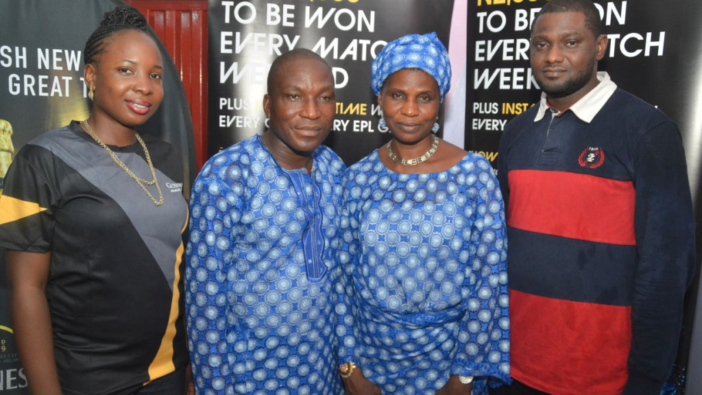 "Territory Manager, Guinness Nigeria Plc., Alero Fawole; N100,000 winners, Mr. and Mrs. Bukola Alaka and Area Sales Manager, Guinness Nigeria Plc., Mr. Seriki Taiwo, at a cheque presentation during the recently concluded Guinness ""Every Minute Made of Black"" football promo in Lagos."