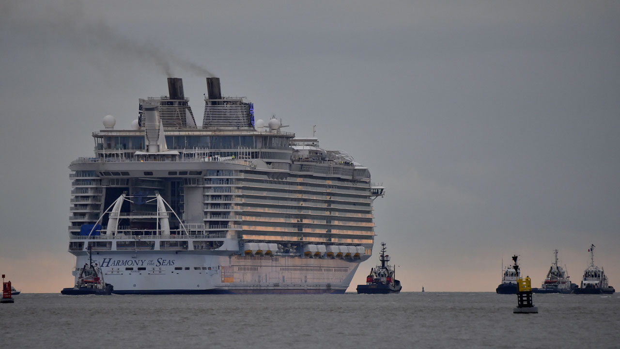 TO GO WITH AFP STORY BY ANNE-SOPHIE LASSERRE (FILES) This file photo taken on March 10, 2016 shows the Harmony of the Seas cruise ship leaving the STX shipyard of Saint-Nazaire, western France, for a three-day offshore test.  STX France will deliver on May 12, 2016 in Saint-Nazaire the Harmony of the Seas, the largest cruise ship ever built, to US owner Royal Caribbean Cruises Ltd (RCCL). / AFP PHOTO / LOIC VENANCE