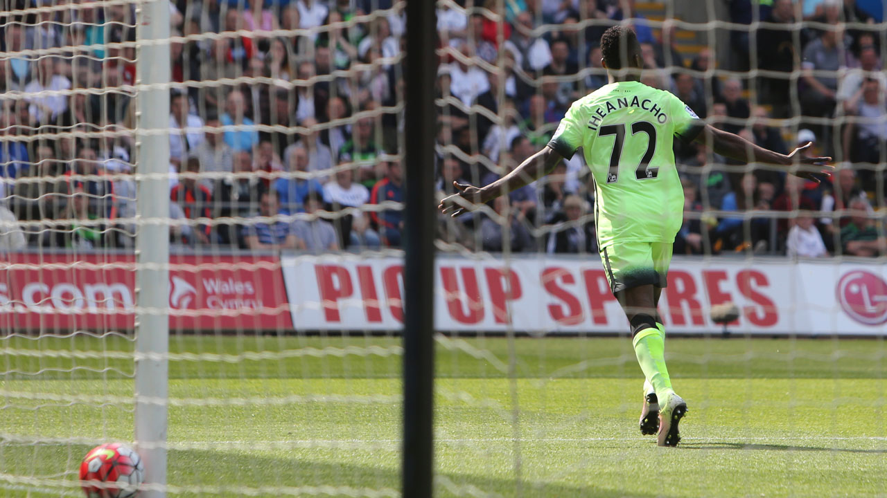 Manchester City's Nigerian striker Kelechi Iheanacho celebrates after scoring the opening goal of the English Premier League football match between Swansea City and Manchester City at The Liberty Stadium in Swansea, south Wales on May 15, 2016. The game finished 1-1. / AFP PHOTO / GEOFF CADDICK /