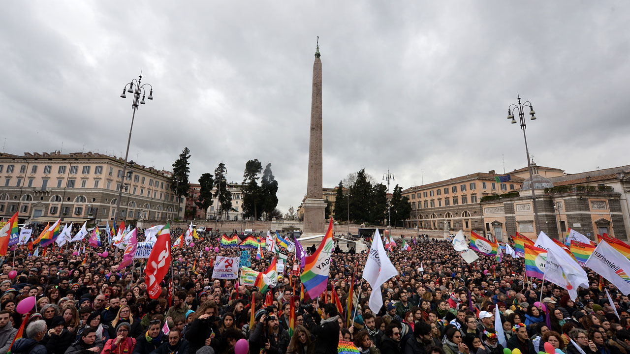 (FILES) This file photo taken on March 05, 2016 shows supporters of LGBT associations taking part in a protest, in central Rome, against the bill on civil union which was approved recently by the Italian Senate. Italy's parliament on May 11, 2016 gave a green light for the introduction of gay civil unions in the last major Western country not to legally recognise same-sex relationships. Lawmakers in the lower-house Chamber of Deputies voted 369-193 in favour of a vote of confidence in the government which makes final approval of the divisive civil unions bill automatic.  / AFP PHOTO / TIZIANA FABI