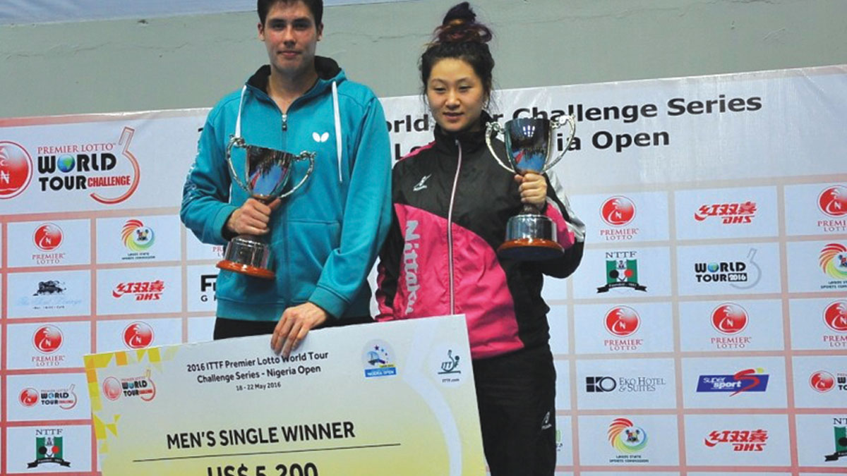 Finland's Benedek Olah (left) and Portugal's Jieni Shao won the Men and Women's Singles title of the ITTF World Tour Premier Lotto Nigeria Open, which ended at the Teslim Balogun Stadium, Lagos… on Sunday. PHOTO: ITTF.COM