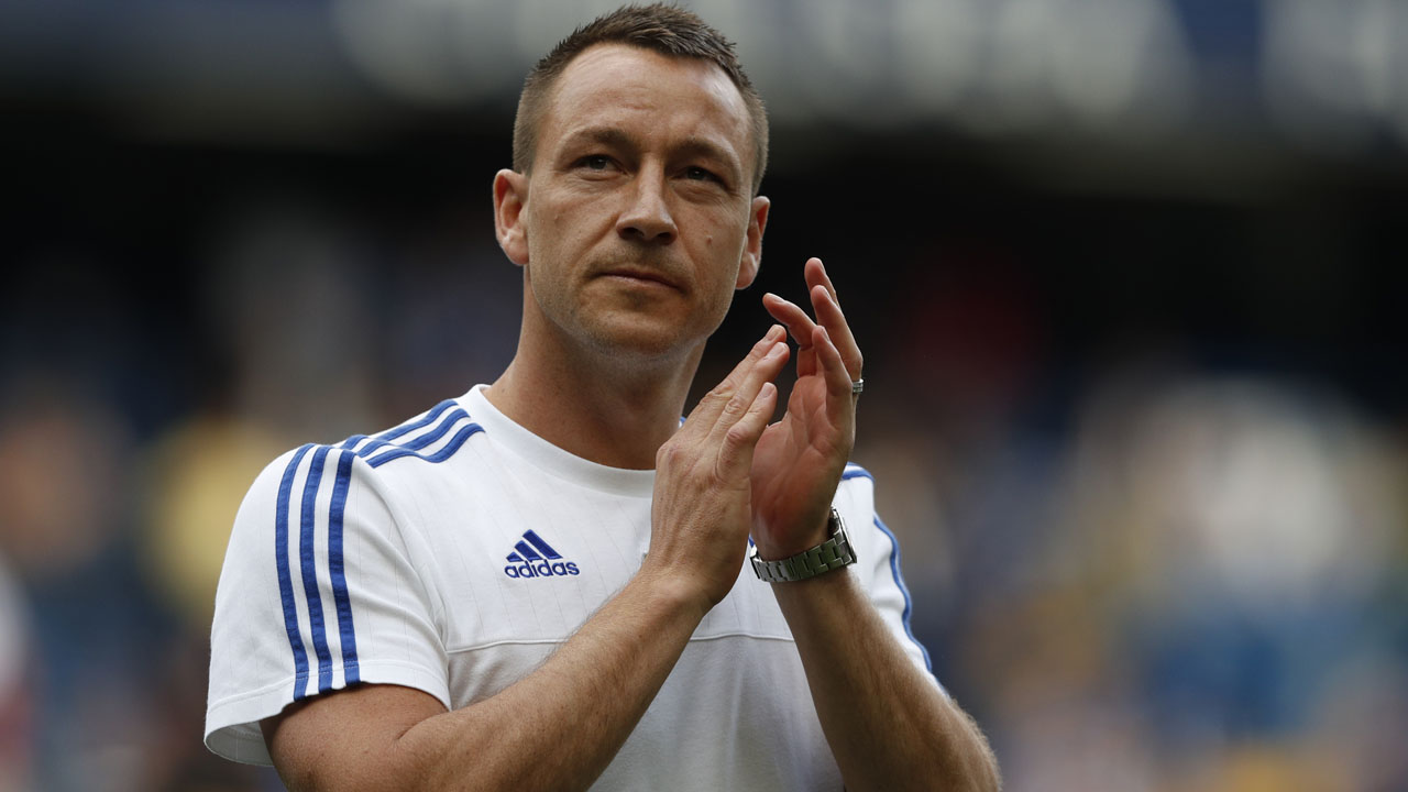 Chelsea's English defender John Terry applauds fans after the English Premier League football match between Chelsea and Leicester City at Stamford Bridge in London on May 15, 2016. / AFP PHOTO / ADRIAN DENNIS /