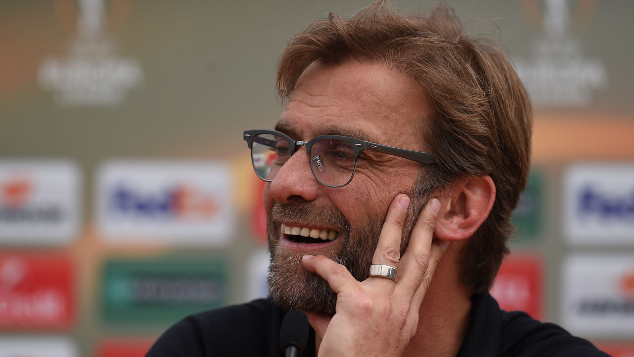 Liverpool's German manager Jurgen Klopp hosts a press conference in Liverpool, north west England, on May 13, 2016. Liverpool face Sevilla in the Europa League on May 18, 2016, with both silverware and a Champions League place up for grabs and Klopp believes this result will provide his side with precious momentum and confidence. / AFP PHOTO / PAUL ELLIS