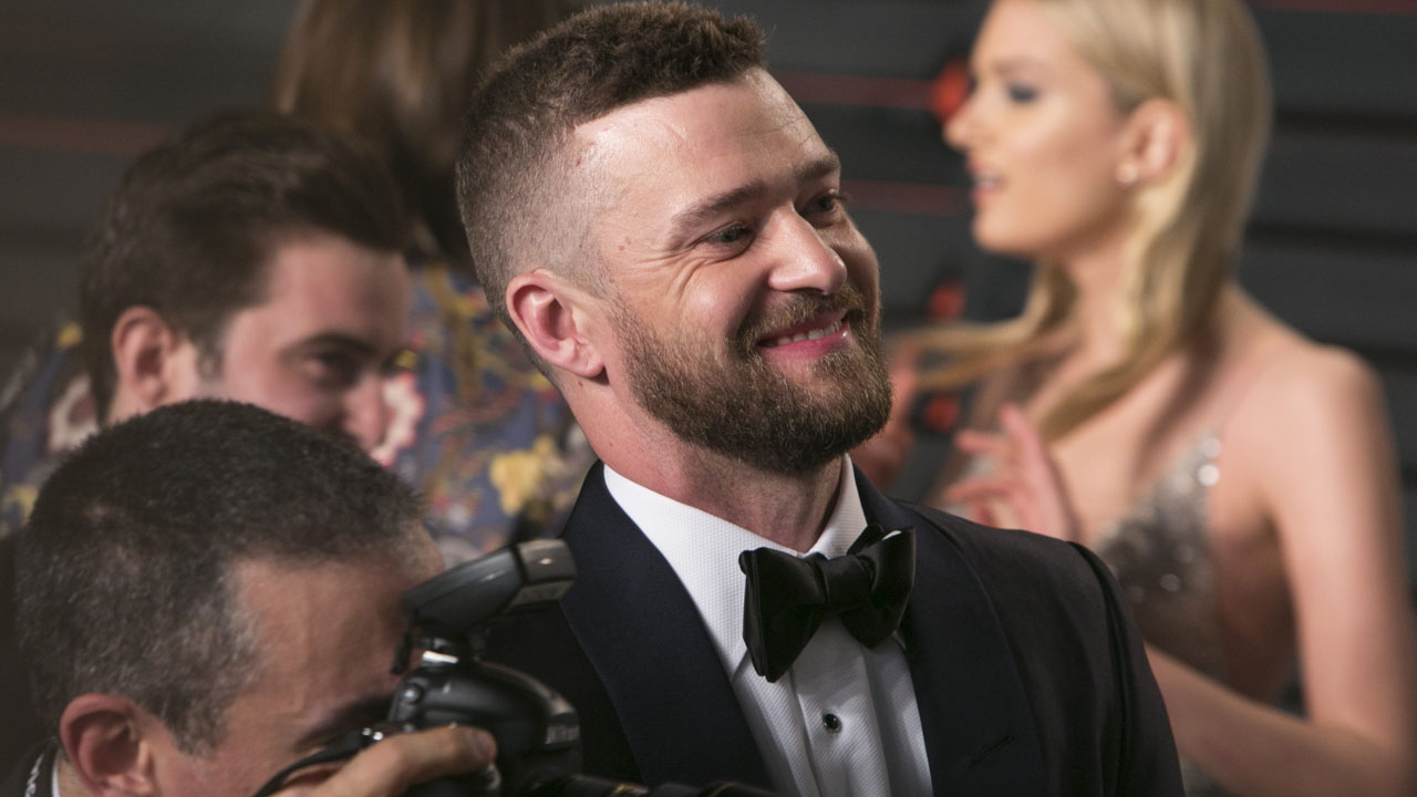 "(FILES) This file photo taken on February 28, 2016 shows US singer and actor Justin Timberlake arrives to the 2016 Vanity Fair Oscar Party  in Beverly Hills, California. Pop superstar Justin Timberlake returned May 6, 2016 with his first new song in three years, a cheery pop number that will appear on his upcoming movie ""Trolls."" Timberlake released a video for ""Can't Stop the Feeling"" in which the singer dances across his studio with appearances by other voice actors from the movie including actress Anna Kendrick and fellow pop star Gwen Stefani.  / AFP PHOTO / ADRIAN SANCHEZ-GONZALEZ"