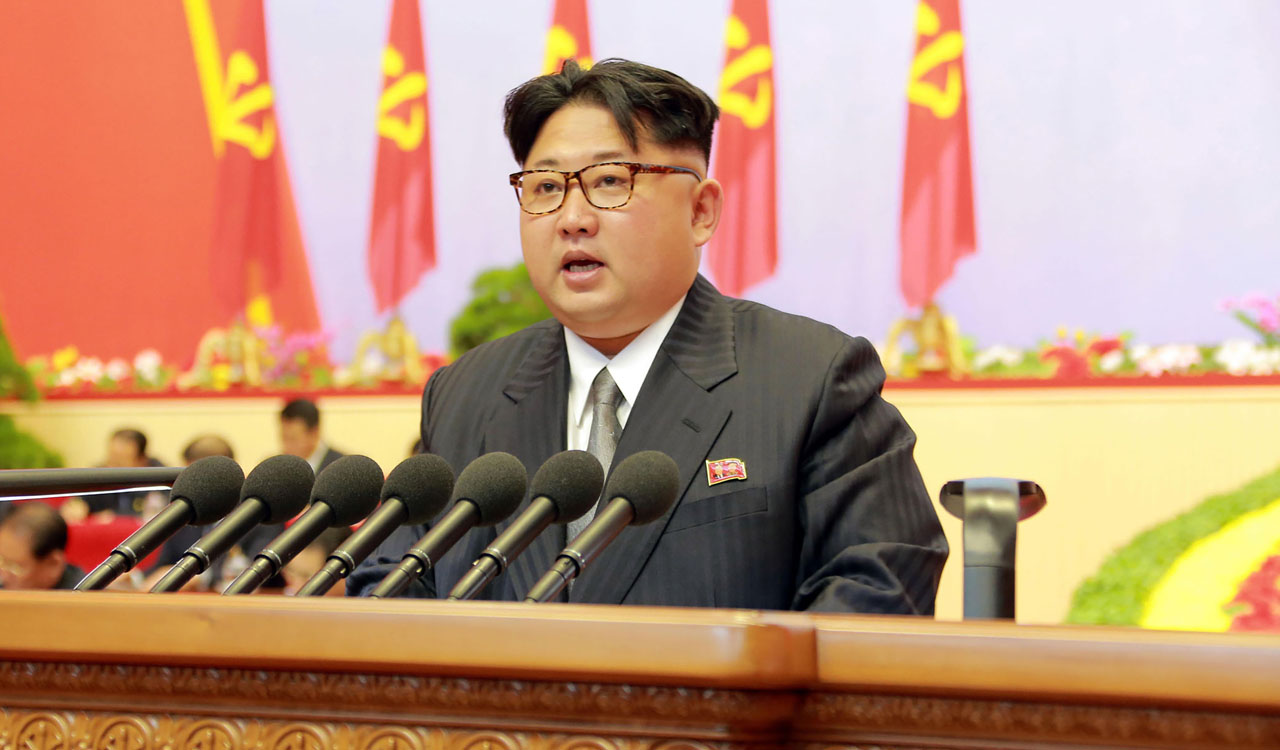 This photo taken on May 8, 2016 and released on May 9 by North Korea's official Korean Central News Agency (KCNA) shows North Korean leader Kim Jong-Un reporting works of the North Korean Workers Party Central Committee during the third day of the 7th Workers Party Congress at the 'April 25 Palace' in Pyongyang. North Korea's first ruling party congress for nearly 40 years formally adopted leader Kim Jong-Un's policy of developing the country's nuclear arsenal in tandem with the economy, state media said on May 9.   / AFP PHOTO / KCNA VIA KNS / KCNA / South Korea OUT / REPUBLIC OF KOREA OUT