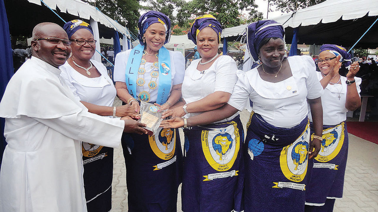 Princess Magdalene Adenike Coker (middle), being congratulated by some members of LACCWO after receiving her award. PHOTO: DEBO OLADIMEJI