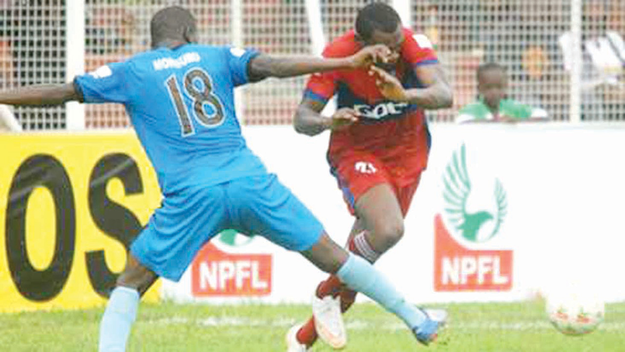 MFM's Monsuru (left) makes an attempt to stop an opponent during one of the fixtures of Nigerian Professional Football League, recently.