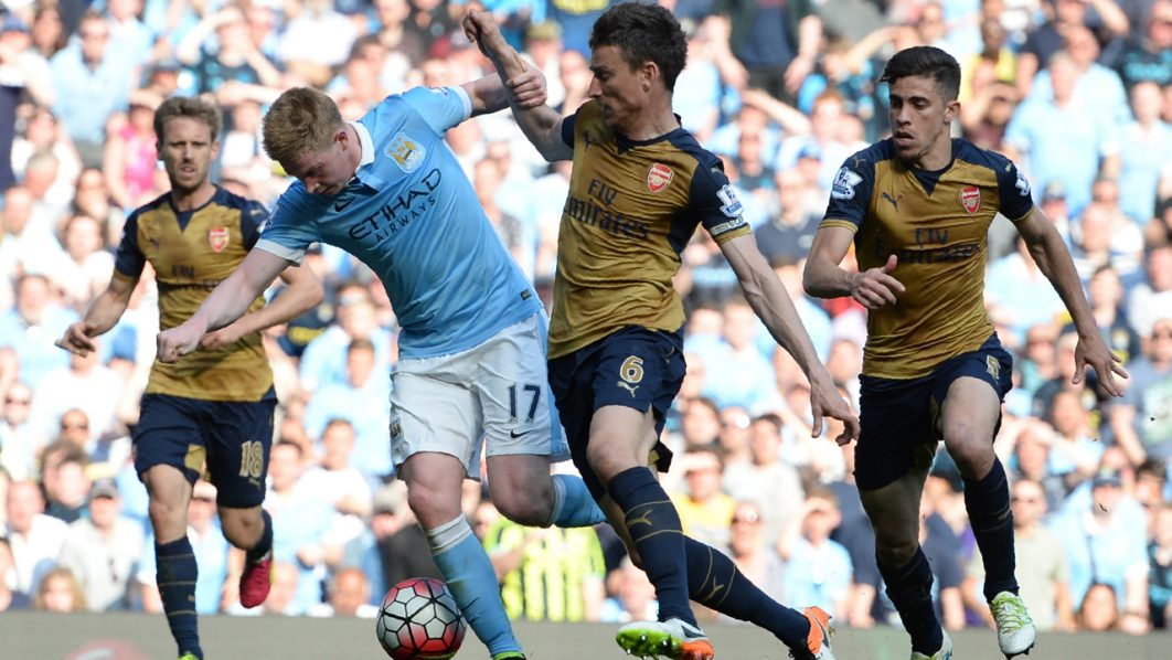 Manchester City's Belgian midfielder Kevin De Bruyne (2L) is tackled by Arsenal's French defender Laurent Koscielny during the English Premier League football match between Manchester City and Arsenal at the Etihad Stadium in Manchester, north west England, on May 8, 2016. / AFP PHOTO / OLI SCARFF