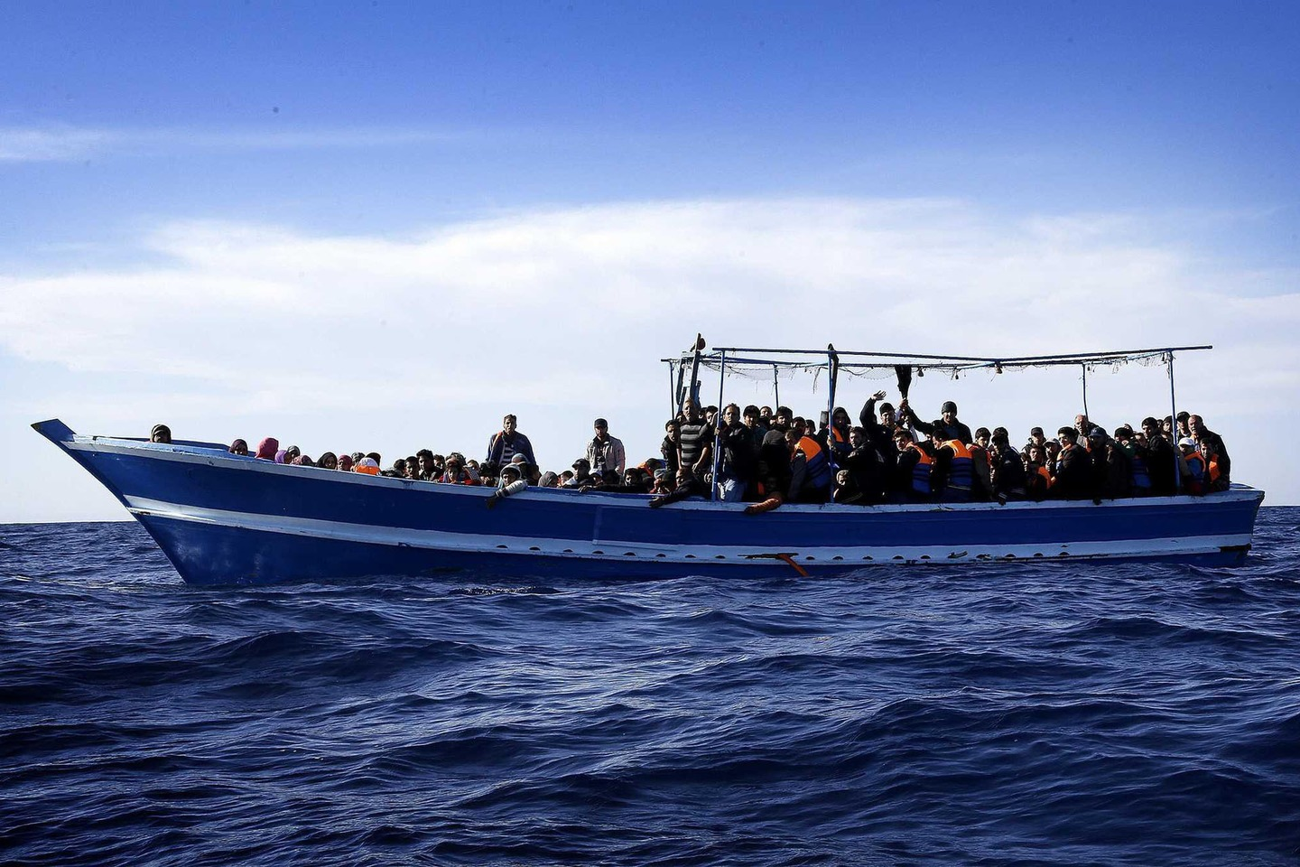 People on a boat carrying 267 migrants, including men, women and children, off the coast of Libya in the southern Mediterranean Sea. PHOTO:AFP