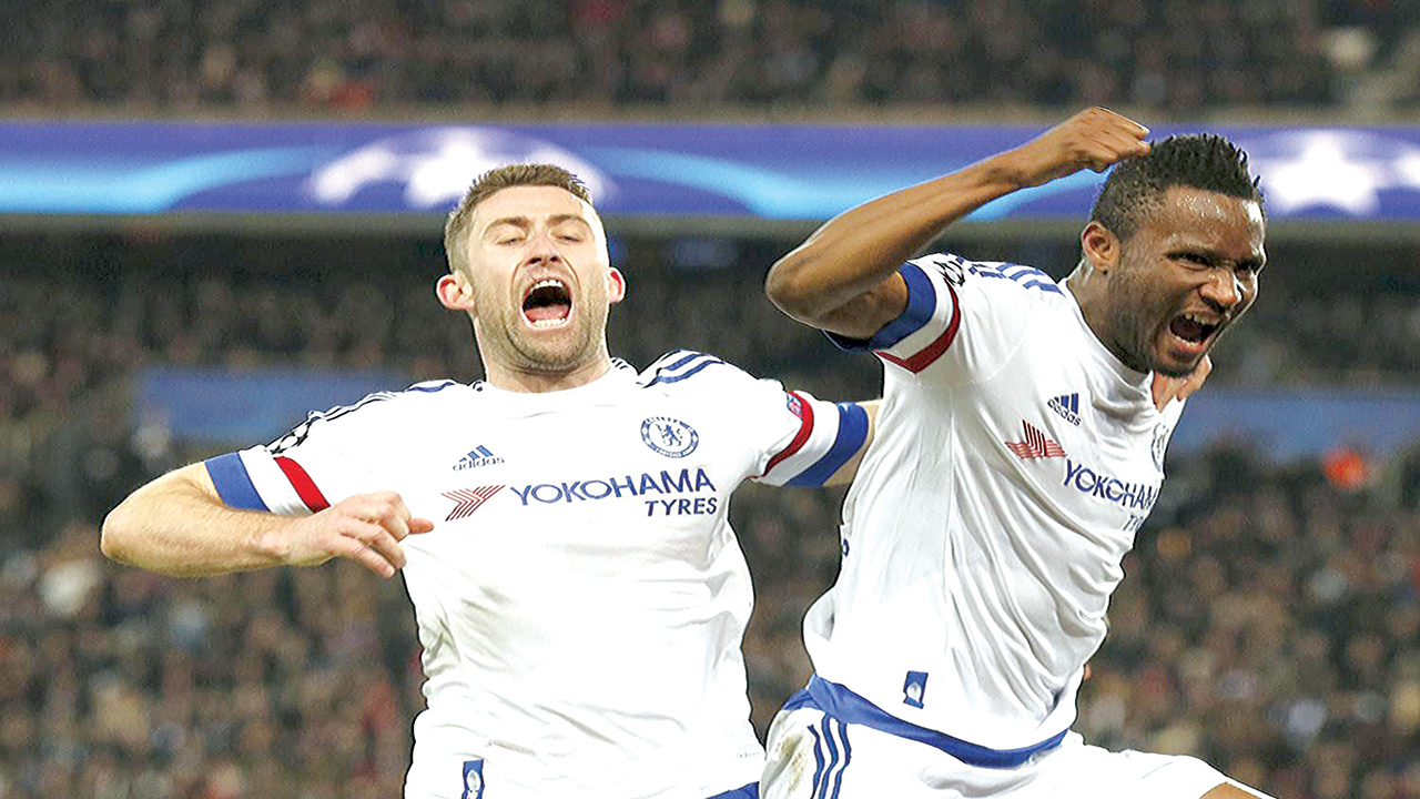 Chelsea's John Obi Mikel (right) celebrates with Gary Cahill after scoring against PSG in the UEFA Champions League…recently. PHOTO: AFP.