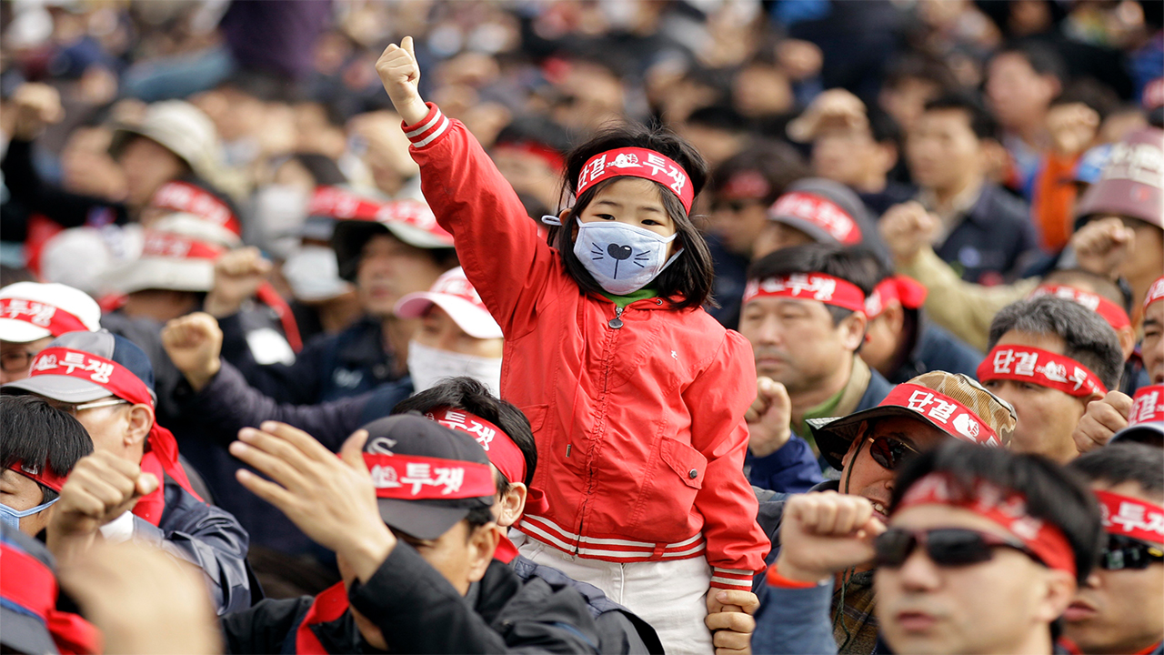 A girl shouts slogans as she joins a May Day rally in downtown Seoul, South Korea, Sunday, PHOTO: AFP