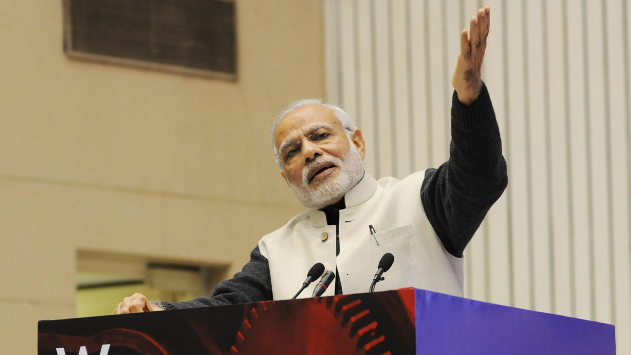 (FILES) This file photo taken on January 16, 2016 shows Indian Prime Minister Narendra Modi gesturing as he speaks during an event to launch an initiative to bolster start-ups in New Delhi. Narendra Modi was elected two years ago this week promising to ease India's notorious red tape and unpack regulatory tangles, but for foreign firms, doing business in the world's fastest-growing large economy can still be a costly headache. With a billion consumers and rising middle class, India holds dazzling potential -- yet despite signs of change on the ground, high-profile corporate tussles continue to bamboozle investors. / AFP PHOTO / -