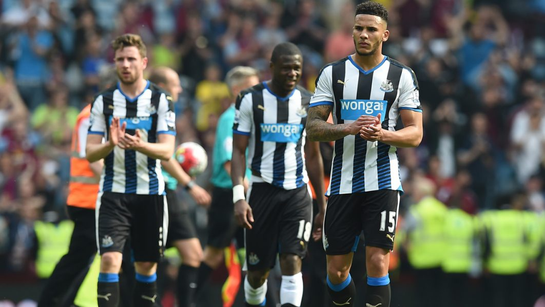 Newcastle United's English defender Jamaal Lascelles (R) reacts on the pitch after the English Premier League football match between Aston Villa and Newcastle United at Villa Park in Birmingham, central England on May 7, 2016. The game ended 0-0. / AFP PHOTO / Paul ELLIS