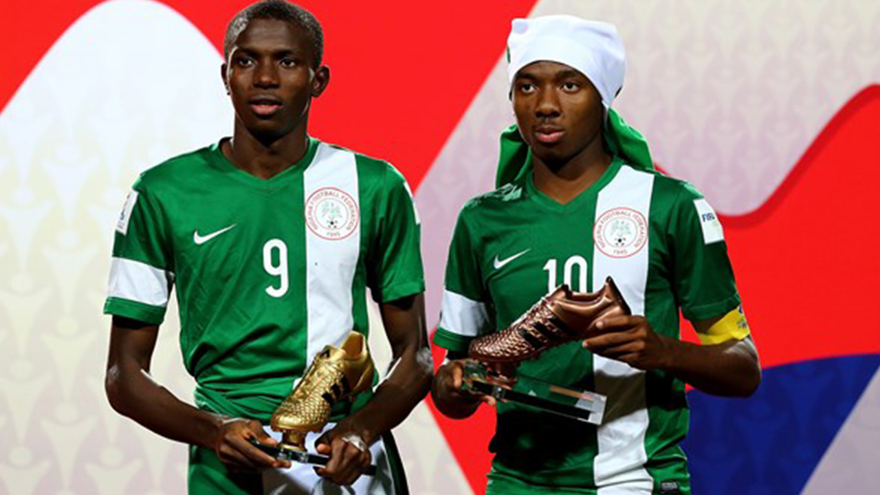 Kelechi Nwakali (R) of Nigeria poses with the adidas bronze boot and team mate Victor Osimhen of Nigeria.