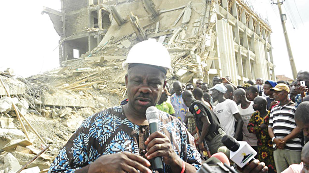 Governor Ibikunle Amosun addressing a crowd at the scene of the collapsed building in Abeokuta…yesterday