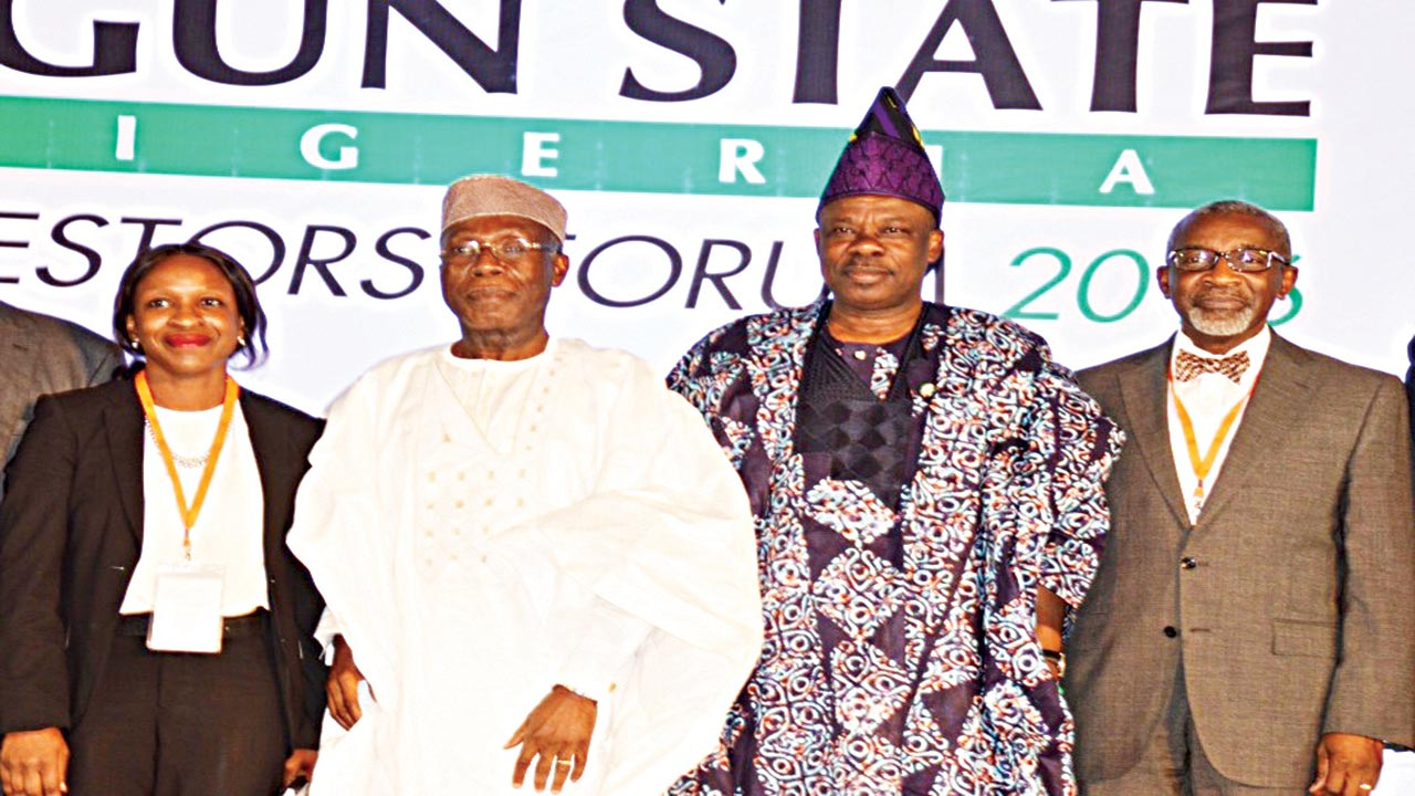 Managing Director, Lafarge Africa Plc, Mrs Adepeju Adebajo (left); Minister for Agriculture, Chief Audu Ogbe; Governor of Ogun State, Senator Ibikunle Amosun; and Chairman, Phillips Consulting, Foluso Phillips, at the closing ceremony of Ogun State investors forum, in Abeokuta, yesterday.