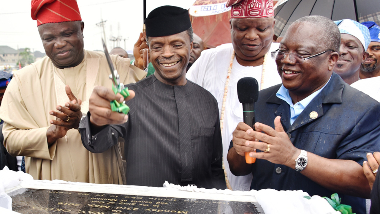 Lagos State Governor Akinwunmi Ambode (left); Vice President Yemi Osinbajo; Osolo of Isolo, Oba Kabiru Adelaja Agbabiaka and Commissioner for Works and Infrastructure, Ganiyu Johnson during the unveiling of a plaque to formally commission the newly constructed Ago Palace Way, Okota, Isolo, Lagos...yesterday.