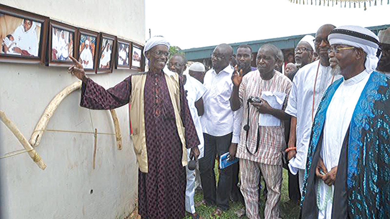 Otaru of Auchi, Ahaji Aliru Momoh (right); Barr. Obahiagbon representing Governor Adams Oshiomhole; and others being conducted round the exhibition stand during the festival