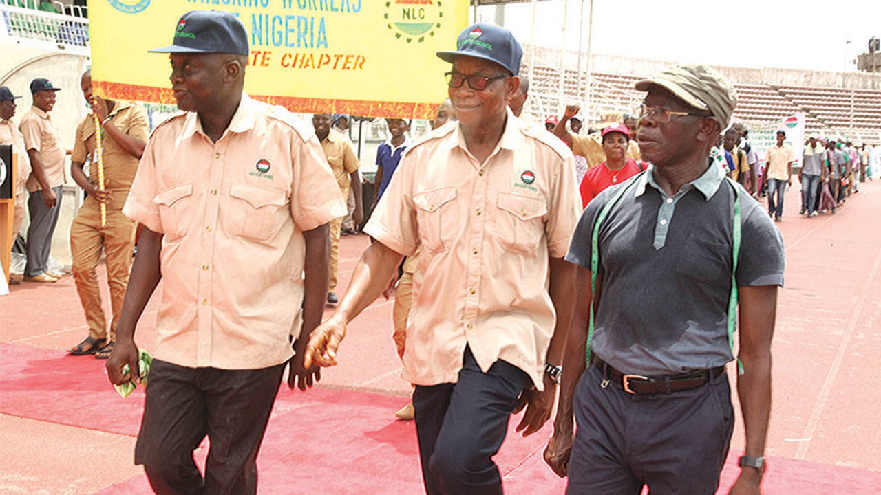 Edo State Governor Adams Oshiomhole (right); Chairman, National Union of Textile Garments and Tailoring Workers, Isaiah Okungbowa and Secretary, Bayo Oladipupo during in the 2016 May Day rally held at the Samuel Ogbemudia Stadium, Benin City.