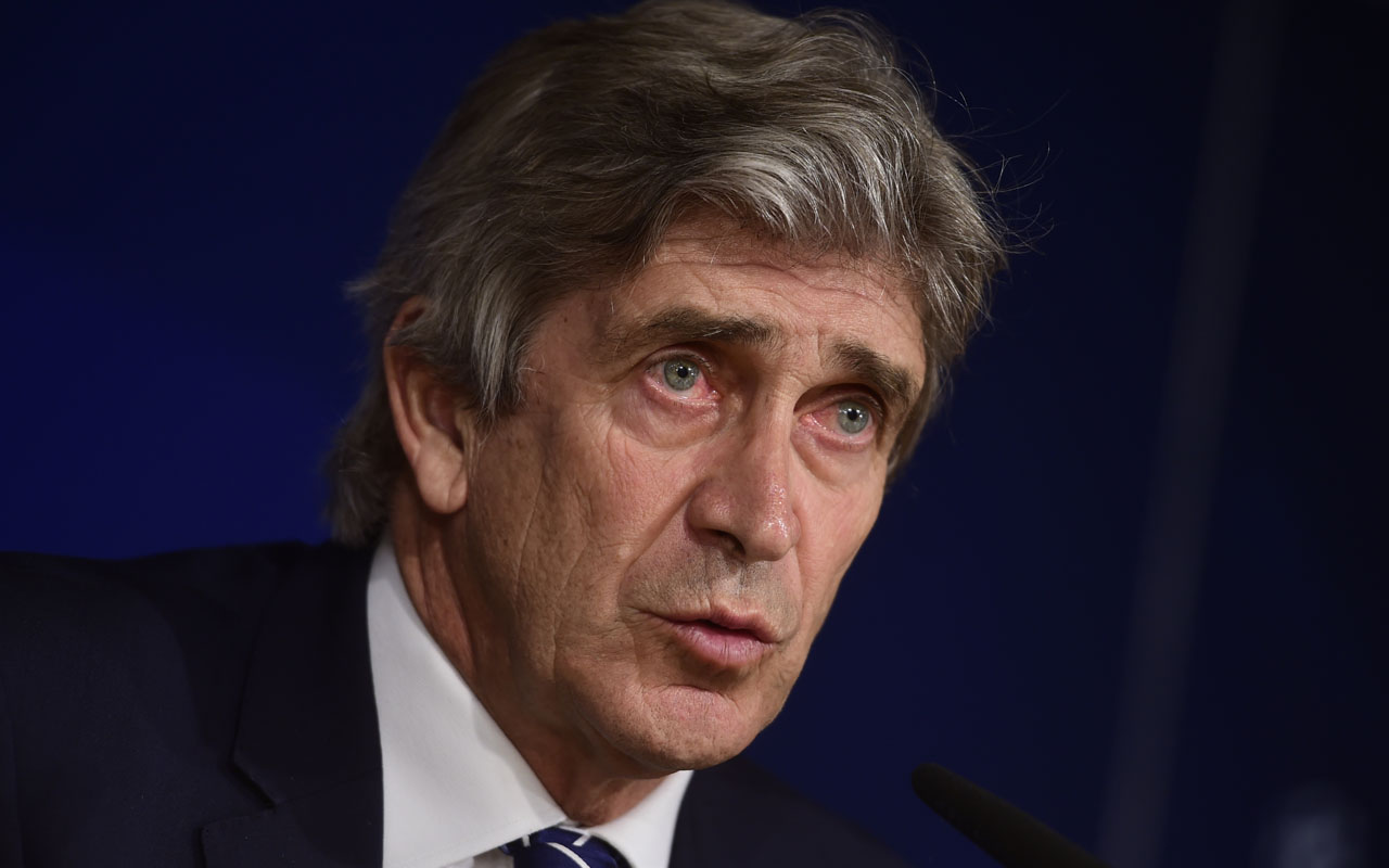Manchester City's Chilean head coach Manuel Pellegrini speaks during a press conference at the Santiago Bernabeu stadium in Madrid on May 3, 2016 on the eve of their Champions League semi-final second leg football match against Real Madrid. / AFP PHOTO / PIERRE-PHILIPPE MARCOU