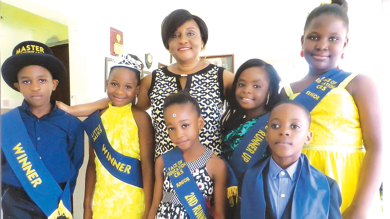 Director, Bridge End International School, Calabar, Cross River State, Dr.Margaret Ndoma-Egba, flanked by winner in the boys' category, Edikan-Abasi Anietie Akpan, (left); Mary Eneji, who won the girls' category and Nmesomachim Domingo, winner junior category (phonics). Others are Rejoice Ikpi, second runner up (girls); Divine Etim Bassey second runner up (boys) and first runner up girls, Nkami Bankoli Bankong , first runner up, during the Face of Education programme, which is aimed at building confidence and educational skills in pupils