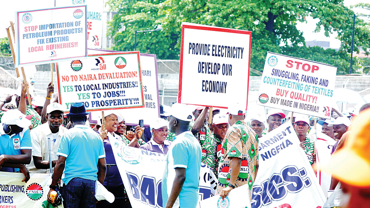 Workers displaying various placards, during May day rally at Onikan Studium in Lagos ... yesterday Photo: FEMI ADEBESIN-KUTI