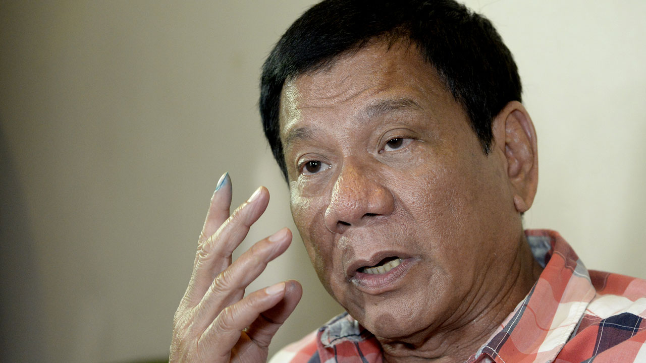 Philippines Presidential frontrunner and Davao City Mayor Rodrigo Duterte gestures as he is interviewed by reporters at a hotel in Davao City on the southern island of Mindanao on May 9, 2016.  Anti-establishment firebrand Rodrigo Duterte was heading for a huge win  in the Philippine presidential elections, according to a poll monitor, after an  incendiary campaign dominated by his profanity-laced threats to kill criminals. / AFP PHOTO / NOEL CELIS