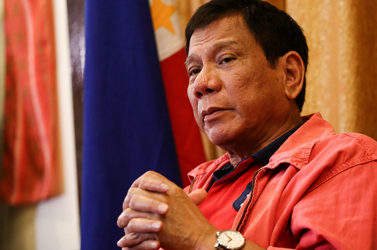 """Philippines' president-elect Rodrigo Duterte speaks during a press conference in Davao City, in southern island of Mindanao on May 26, 2016.  Explosive incoming Philippine president Rodrigo Duterte has launched a series of obscenity-filled attacks on the Catholic Church, branding local bishops corrupt """"sons of whores"""" who are to be blamed for the nation's fast-growing population. / AFP PHOTO / MANMAN DEJETO"""