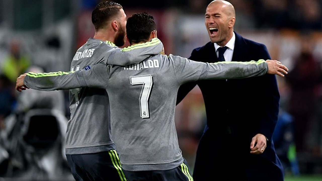 Ronaldo celebrates with Sergio Ramos and Zinedine Zidane. PHOTO: AFP