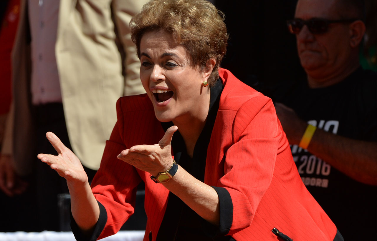 Brazilian President Dilma Rousseff gestures during a demonstration to mark International Workers' Day, in Sao Paulo, Brazil, on May 1, 2016. / AFP PHOTO / NELSON ALMEIDA
