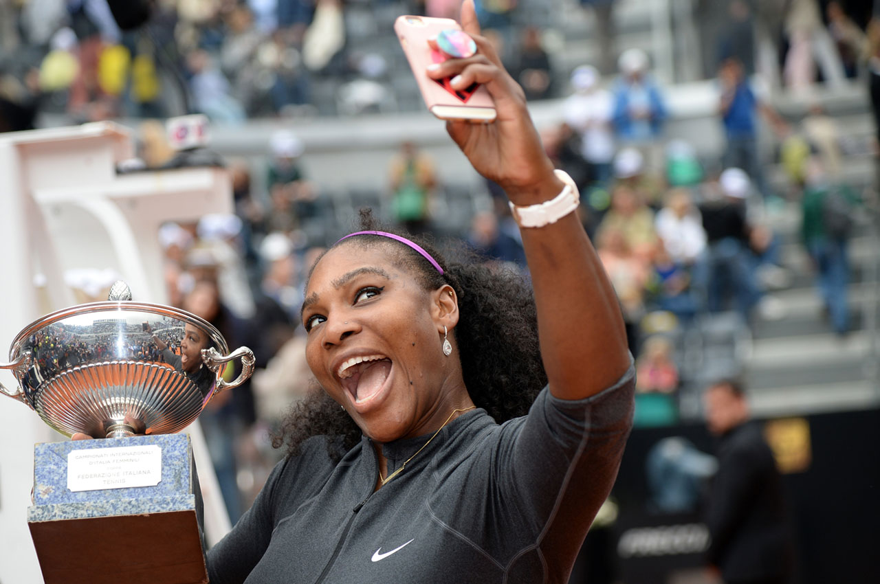 US Serena Williams takes a selfie with the trophy after winning the final match of the WTA Tennis Open tournament game against US Madison Keys at the Foro Italico in Rome on May 15, 2016.     / AFP PHOTO / FILIPPO MONTEFORTE