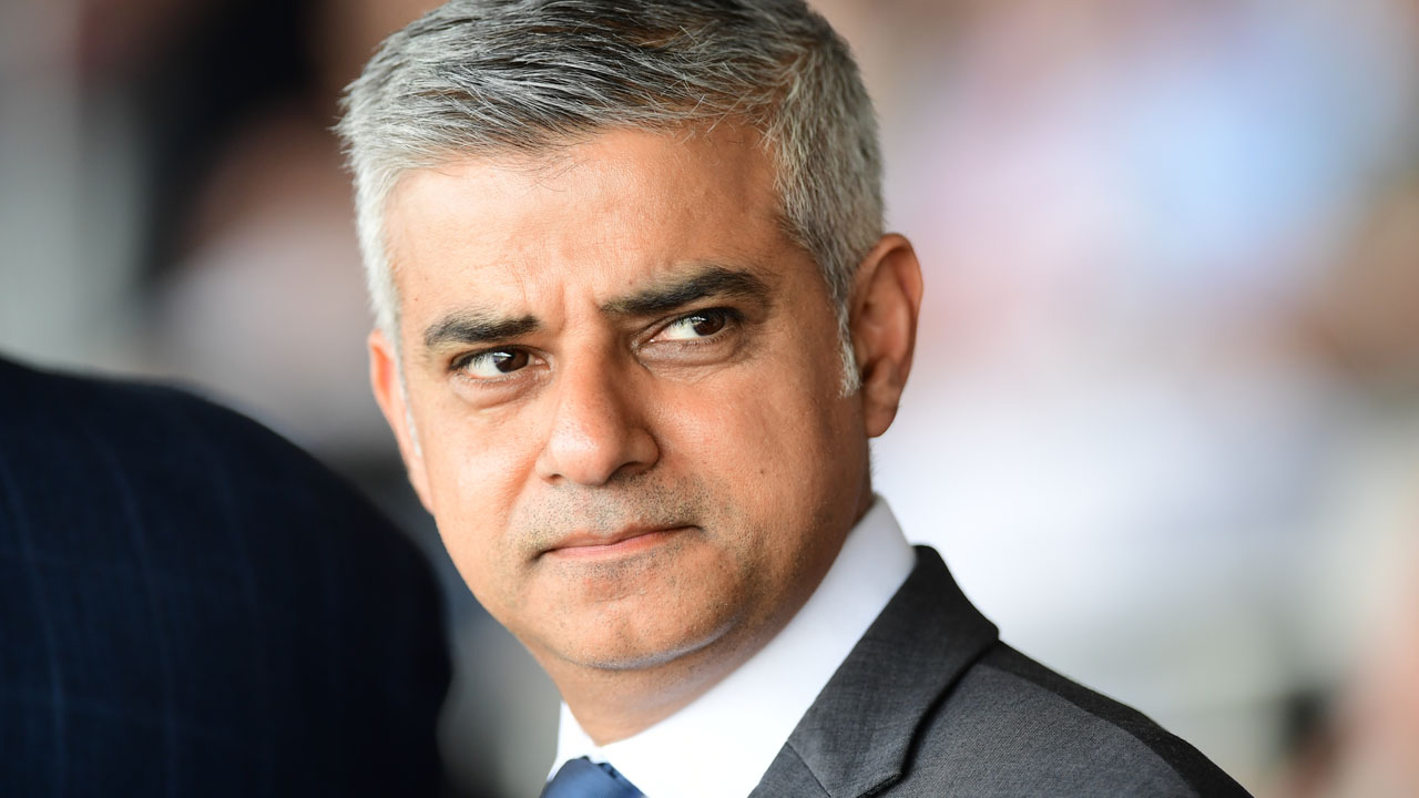 "Britain's new London Mayor Sadiq Khan attends the Yom HaShoah Commemoration, the UK Jewish community's Holocaust remembrance ceremony, in Barnet, north London, on May 8, 2016. London's new Muslim mayor Sadiq Khan accused Prime Minister David Cameron on Sunday of using ""Donald Trump playbook"" tactics to try to divide communities in a bid to prevent his election. Khan won 57 percent of the vote in the May 5 mayoral election, securing 1.3 million votes to see off multimillionaire Tory Zac Goldsmith and making history as the first Muslim mayor of a major Western capital. / AFP PHOTO / LEON NEAL"