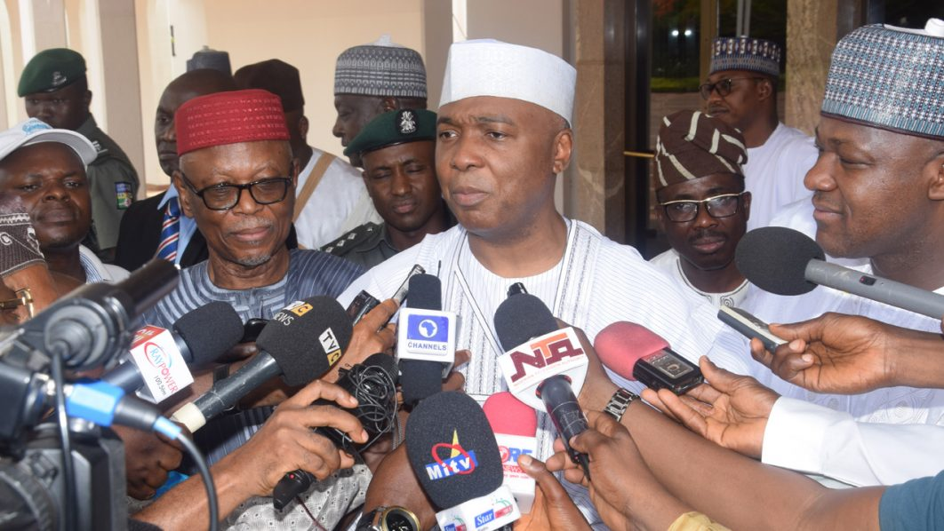 Senate President Bukola Saraki briefing State House Correspondents, after the signing the 2016 Budget into Law by President Muhammadu Buhari, at the Presidential Villa Abuja on Friday, May 6, 2016. On his (left) Speaker House of Representatives Hon. Yakubu Dogara and APC National Chairman John Oyegun, on his right. PHOTO: Philip Ojisua