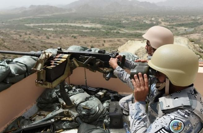 Saudi border guards look out across the Yemen border.PHOTO:AFP