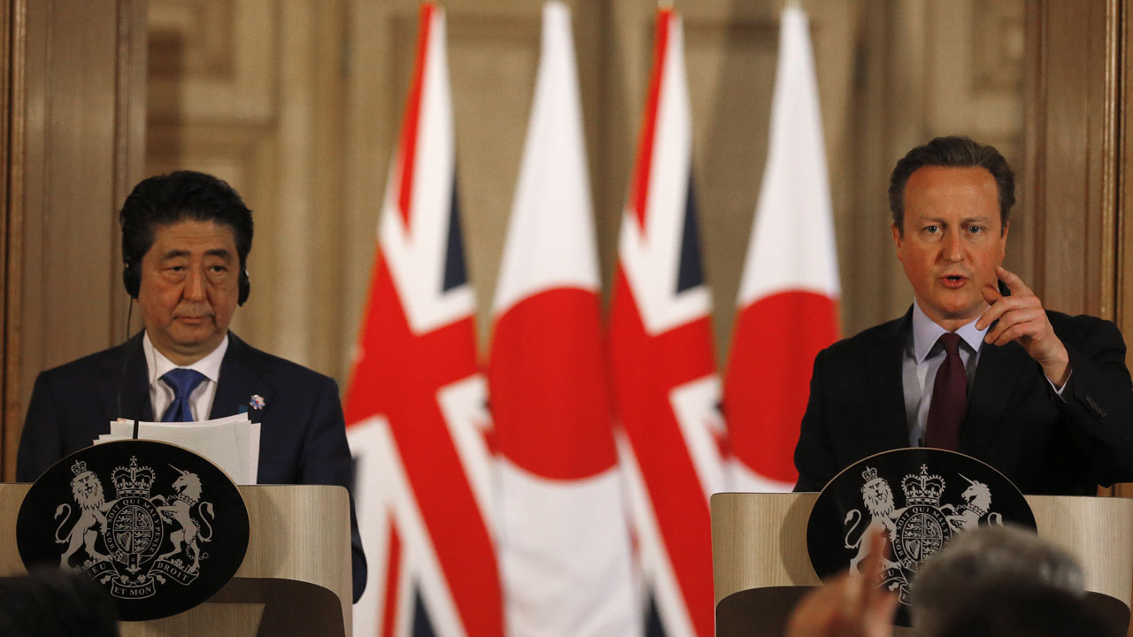 "British Prime Minister David Cameron (R) and Japanese Prime Minister Shinzo Abe attend a joint press conference following their meeting inside 10 Downing Street in central London on May 5, 2016. Prime Minister Shinzo Abe warned that Britain would become ""less attractive"" for Japanese investment if it votes to leave the European Union in a membership referendum in June. ""A vote to leave would make the UK less attractive as a destination for Japanese investment,"" Abe said. / AFP PHOTO / POOL / Frank Augstein"