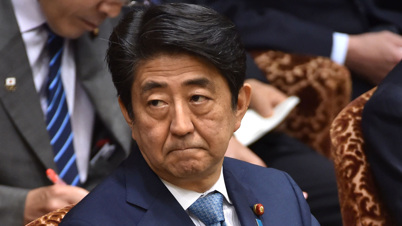 This picture taken on May 13, 2016 shows Japanese Prime Minister Shinzo Abe attending a budget committee session of the House of Councillors in Tokyo.  Abe has decided to postpone a sales tax hike a second time, judging that boosting the tariff could hurt the world's third-largest economy, a newspaper said May 14. / AFP PHOTO / KAZUHIRO NOGI