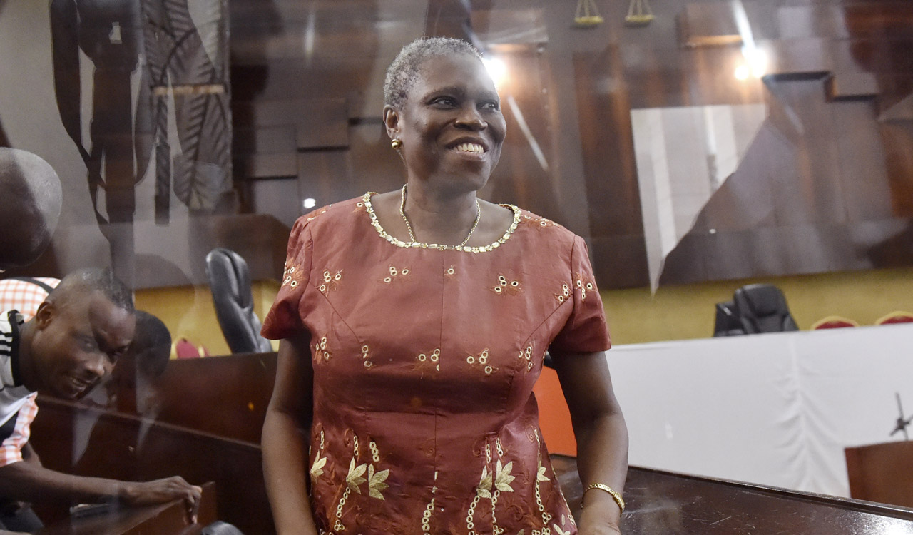 "(FILES) This file photo taken on May 9, 2016 shows Ivory Coast's former first lady Simone Gbagbo attending the opening hearing of her trial on charges of crimes against humanity for her alleged role in the 2010 electoral violence, at the courthouse of Abidjan. Nicknamed the ""Iron Lady"", the 66-year-old had already been sentenced to 20 years in jail last year for ""attacking state authority"" for her role in violence which followed elections in 2010 which her husband Laurent Gbagbo lost. The Former first Lady of Ivory-Coast is due to appear on May 31 at the courthouse of Abidjan, in a new trial that bypass the demand of the International Court of Justice in The Hague. / AFP PHOTO / ISSOUF SANOGO"