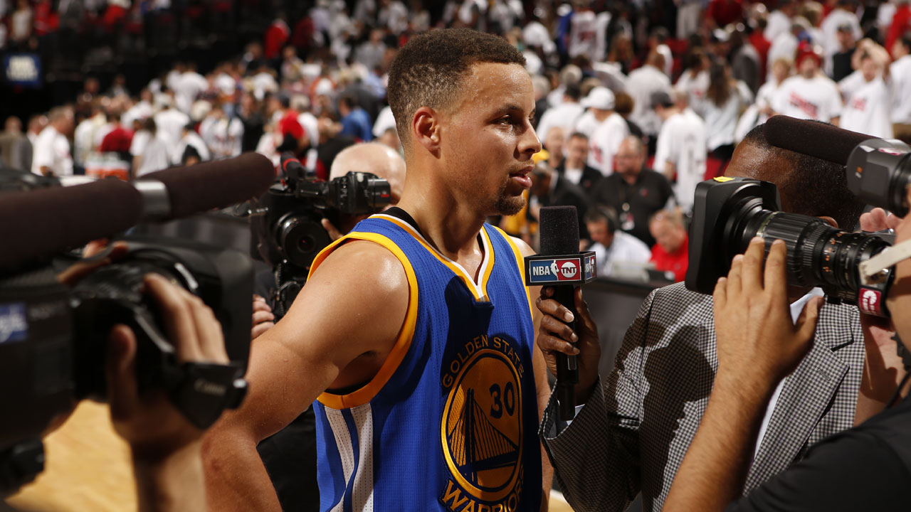 PORTLAND, OR - MAY 9: Stephen Curry #30 of the Golden State Warriors is interviewed after Game Four of the Western Conference Semifinals against the Portland Trail Blazers during the 2016 NBA Playoffs on May 9, 2016 at the Moda Center in Portland, Oregon. NOTE TO USER: User expressly acknowledges and agrees that, by downloading and or using this Photograph, user is consenting to the terms and conditions of the Getty Images License Agreement. Mandatory Copyright Notice: Copyright 2016 NBAE   Cameron Browne/NBAE via Getty Images/AFP